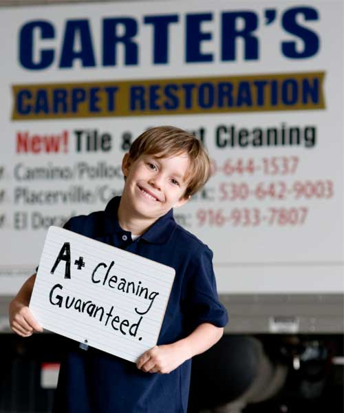 boy and carpet cleaning truck